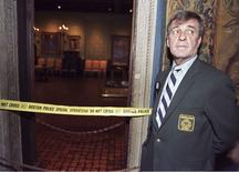 Security guard Paul Daley stands guard at the door of the Dutch Room following a robbery at the Isabella Stewart Gardner Museum in Boston, in this file photo taken March 21,1990.  REUTERS/Jim Bourg/Files