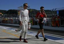 Marussia Formula One driver Max Chilton of Britain walks along the pitlane after the third free practice session at the Russian F1 Grand Prix in the Sochi Autodrom circuit October 11, 2014. REUTERS/Maxim Shemetov