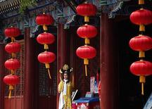 Ресторан в Пекине. 8 мая 2014 года. Активность в секторе услуг Китая немного ускорилась в феврале, так как число новых запасов росло самыми быстрыми темпами за три месяца. REUTERS/Kim Kyung-Hoon