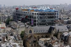 General view of the Paris skyline, the Saint-Merri Church (front) and the Centre Pompidou modern art museum, also known as Beaubourg, on July 5, 2013.  REUTERS/Philippe Wojazer