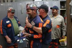 Miners fool around in their locker room prior to the start of an afternoon shift at a coal mine near Gilbert, West Virginia May 22, 2014.   REUTERS/Robert Galbraith