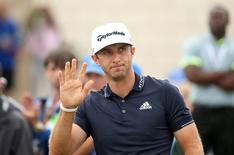 Dustin Johnson acknowledges the crowd before his tee shot on the first hole during the final round of the WGC - Cadillac Championship golf tournament at TPC Blue Monster at Trump National Doral. Mandatory Credit: Jason Getz-USA TODAY Sports