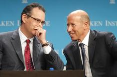 """David Simon (L), chairman and CEO of Simon Property Group Inc., talks to Barry Sternlicht, chairman and CEO of the Starwood Capital Group, during """"The Changing Winds in the Real Estate Market"""" panel session at the Milken Institute Global Conference in Beverly Hills, California April 30, 2012.  REUTERS/Fred Prouser"""