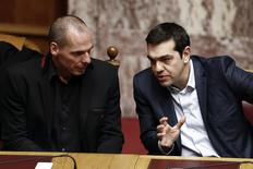 Greek Prime Minister Alexis Tsipras (R) and Finance Minister Yanis Varoufakis talk during the first round of a presidential vote at the Greek parliament in Athens, February 18, 2015.   REUTERS/Alkis Konstantinidis
