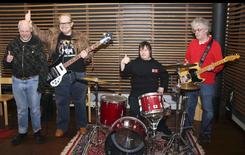 Members of the Finnish punk band Pertti Kurikan Nimipaivat (L-R) Kari Aalto, Sami Helle, Toni Valitalo and Pertti Kurikka pose for a picture in their rehearsal room in Helsinki March 6, 2015. REUTERS/Attila Cser