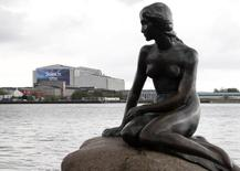"""The landmark sculpture """"Little Mermaid"""" is pictured next to the B&W Hallerne where the grand final of the 59th annual Eurovision Song Contest will take part later on Saturday in Copenhagen May 10, 2014.  REUTERS/Tobias Schwarz"""
