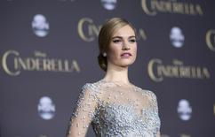 """Cast member Lily James poses at the premiere of """"Cinderella"""" at El Capitan theatre in Hollywood, California March 1, 2015.  REUTERS/Mario Anzuoni"""