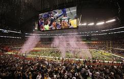 Green Bay Packers' Aaron Rodgers is seen on the big screen as the Packers celebrate their win over the Pittsburgh Steelers during the NFL's Super Bowl XLV football game in Arlington, Texas, February 6, 2011.  REUTERS/Gary Hershorn