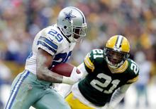 DeMarco Murray (29) runs past Ha Ha Clinton-Dix (21) in the fourth quarter in the 2014 NFC Divisional playoff football game at Lambeau Field. Jan 11, 2015; Green Bay, WI, USA; Jeff Hanisch-USA TODAY Sports