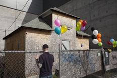 """A century-old Seattle house formerly owned by Edith Macefield and featured in a marketing stunt to publicize Walt Disney Co's balloon adventure movie """"Up"""", is pictured in Seattle, Washington March 13, 2015. REUTERS/David Ryder"""