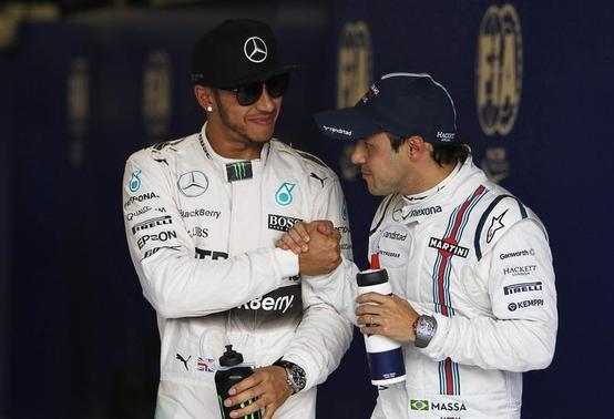 Williams Formula One driver Felipe Massa of Brazil (R) congratulates Mercedes driver Lewis Hamilton of Britain on his pole position after the qualifying session of the Australian F1 Grand Prix at the Albert Park circuit in Melbourne March 14, 2015.   REUTERS/Brandon Malone