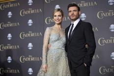 """Cast members Lily James and Richard Madden pose at the premiere of """"Cinderella"""" at El Capitan theatre in Hollywood, California March 1, 2015. REUTERS/Mario Anzuoni"""