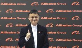 Alibaba founder and chairman Jack Ma poses for the media while touring the CeBIT trade fair in Hanover March 16, 2015. REUTERS/Fabian Bimmer