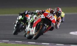 Honda MotoGP rider Marc Marquez of Spain rides his bike during the Qatar MotoGP Grand Prix at the Losail International circuit in Doha March 23, 2014.  REUTERS/Stringer