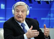 George Soros, Chairman of Soros Fund Management, speaks during the session 'Recharging Europe' in the Swiss mountain resort of Davos January 23, 2015.    REUTERS/Ruben Sprich