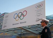 A Monaco's policeman stands in front of the Grimaldi Forum during the opening of the 127th International Olympic Committee (IOC) session in Monaco December 8, 2014.  REUTERS/Eric Gaillard/Files