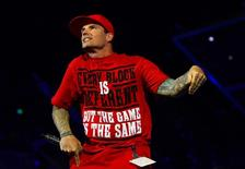 Hip-hop artist Vanilla Ice performs during the 2014 NBA All Star dunk contest  at Smoothie King Center. Mandatory Credit: Bob Donnan-USA TODAY Sports