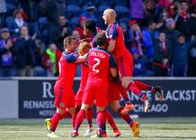 Apr 4, 2015; Chicago, IL, USA; Chicago Fire midfielder Jeff Larentowicz (20) is congratulated for scoring a goal during the second half against the Toronto FC at Toyota Park. Dennis Wierzbicki-USA TODAY Sports