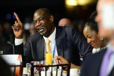 NBA legend Dikembe Mutombo laughs during the 2014 NBA All-Star Game Legends Brunch at Ernest N. Morial Convention Center. Mandatory Credit: Bob Donnan-USA TODAY Sports