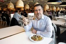 """Michael La Cour, IKEA Food Business Managing Director, poses with the new """"Veggie balls"""" course or vegetarian balls during its official launch at a IKEA store in Brussels April 8, 2015. REUTERS/Francois Lenoir"""