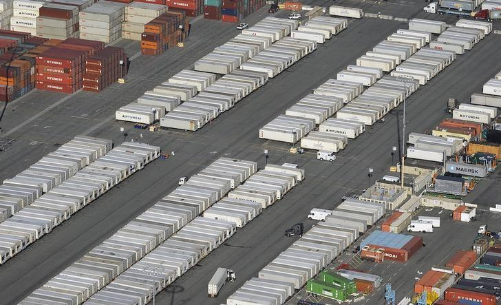 Containers are seen stacked up at the ports of Los Angeles and Long Beach, California February 6, 2015 in this aerial image. REUTERS/Bob Riha Jr