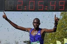 Mark Korir of Kenya crosses the finish line to win the 39th Paris Marathon in Paris April 12, 2015. REUTERS/Benoit Tessier
