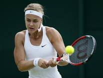 Anna Karolina Schmiedlova of Slovakia hits a return to Alize Cornet of France during their women's singles tennis match at the Wimbledon Tennis Championships, in London June 24, 2014. REUTERS/Stefan Wermuth