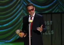 Actor Robert Downey Jr. accepts the MTV Generation Award during the 2015 MTV Movie Awards in Los Angeles, California April 12, 2015. REUTERS/Mario Anzuoni