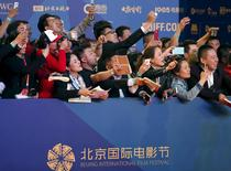 People react as celebrities arrive on the red carpet at the Beijing International Film Festival, in Beijing, April 16, 2015. REUTERS/Kim Kyung-Hoon