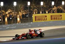Ferrari Formula One Driver Sebastian Vettel of Germany drives during the second free practice ahead of Bahrain's F1 Grand Prix at Bahrain International Circuit, south of Manama, April 17, 2015. REUTERS/Ahmed Jadallah