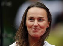 Martina Hingis of Switzerland smiles at a ceremony to celebrate the 30th anniversary of the Pan Pacific Open tennis tournament after the women's final match between Petra Kvitova of the Czech Republic and Angelique Kerber of Germany in Tokyo in this file photo taken on September 28, 2013.   REUTERS/Toru Hanai