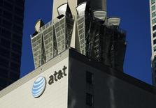 An AT&T logo and communication equipment is shown on a building in downtown Los Angeles, California October 29, 2014. REUTERS/Mike Blake