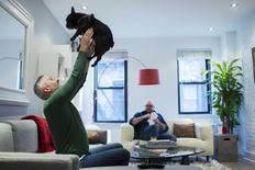 LGBT activist Daniel Maury relaxes at home with his partner, Mark Paulson, and dog Luca in New York April 13, 2015.  REUTERS/Lucas Jackson