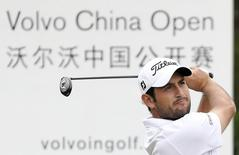 Alexander Levy of France tees off during the first day of the China Open at Tomson Golf Club in Pudong, Shanghai, April 23, 2015. REUTERS/Stringer