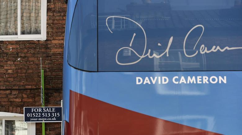 The Conservative Party campaign bus waits outside a venue in Lincoln, Britain April 24, 2015. REUTERS/Toby Melville