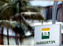 The Petrobras logo is reflected in the window of the company's headquarters in Sao Paulo April 23, 2015. REUTERS/Paulo Whitaker