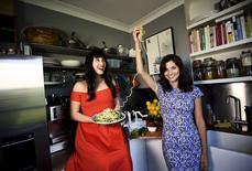 Cookery writers Melissa (L) and Jasmine Hemsley pose for a portrait at Melissa's flat in London, Britain, April 29, 2015. REUTERS/Dylan Martinez