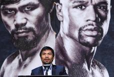 WBO welterweight champion Manny Pacquiao of the Philippines speaks during a final news conference at the MGM Grand Arena in Las Vegas, Nevada April 29, 2015.  REUTERS/Las Vegas Sun/Steve Marcus