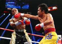 May 2, 2015; Las Vegas, NV, USA; Floyd Mayweather and Manny Pacquiao box during their world welterweight championship bout at MGM Grand Garden Arena. Mandatory Credit: Mark J. Rebilas-USA TODAY Sports