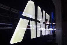 A man is reflected in a logo for the Australia and New Zealand Banking Group Ltd (ANZ) as he walks past a branch located in a Sydney suburb February 17, 2015.  REUTERS/David Gray