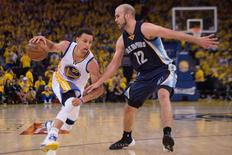 May 3, 2015; Oakland, CA, USA; Golden State Warriors guard Stephen Curry (30) dribbles the basketball against Memphis Grizzlies guard Nick Calathes (12) during the third quarter in game one of the second round of the NBA Playoffs at Oracle Arena.  Kyle Terada-USA TODAY
