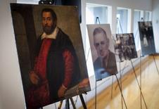 "The 17th century painting ""Portrait of a Man"" which belonged to German Holocaust victim Dr. August Liebmann Mayer, (seen in photo at center) is displayed at a ceremony at the Jewish Heritage Museum in New York officially returning the painting to Mayer's heir, May 5, 2015.  REUTERS/Mike Segar"