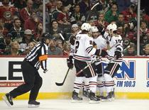 May 5, 2015; Saint Paul, MN, USA;  Chicago Blackhawks defenseman Duncan Keith (L) and forward Patrick Sharp(R) congratulate forward Patrick Kane (C) on his goal during the first period in game three of the second round of the 2015 Stanley Cup Playoffs at Xcel Energy Center. Mandatory Credit: Marilyn Indahl-USA TODAY Sports