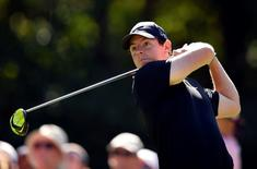 May 7, 2015; Ponte Vedra Beach, FL, USA; Rory McIlroy hits his tee shot on the 15th hole during the first round of The Players Championship golf tournament at TPC Sawgrass - Stadium Course. Mandatory Credit: John David Mercer-USA TODAY Sports