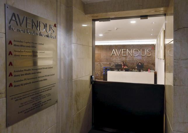 Employees work at the reception desk of the Avendus office in Mumbai, India, May 7, 2015. REUTERS/Shailesh Andrade