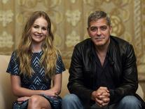 "Cast members George Clooney and Britt Robertson pose for a portrait while promoting their upcoming movie ""Tomorrowland"" in Beverly Hills, California May 8, 2015.  REUTERS/Mario Anzuoni"
