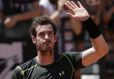 Andy Murray of Britain celebrates after beating Jeremy Chardy of France in their second round match at the Rome Open tennis tournament in Rome, Italy, May 13, 2015.  REUTERS/Max Rossi