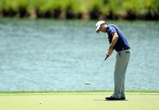 May 8, 2015; Ponte Vedra Beach, FL, USA; Robert Streb putts on the 17th green during the second round of The Players Championship golf tournament at TPC Sawgrass - Stadium Course. Mandatory Credit: Jake Roth-USA TODAY Sports