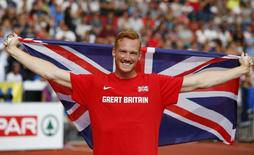 Greg Rutherford of Britain celebrates after winning the men's long jump final during the European Athletics Championships at the Letzigrund Stadium in Zurich August 17, 2014. REUTERS/Phil Noble