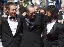 "Director Laszlo Nemes, Mathias Erde and cast member Geza Rohrig pose on the red carpet as they arrive for the screening of the film ""Saul Fia"" (Son of Saul) in competition at the 68th Cannes Film Festival in Cannes, southern France, May 15, 2015.  REUTERS/Yves Herman"